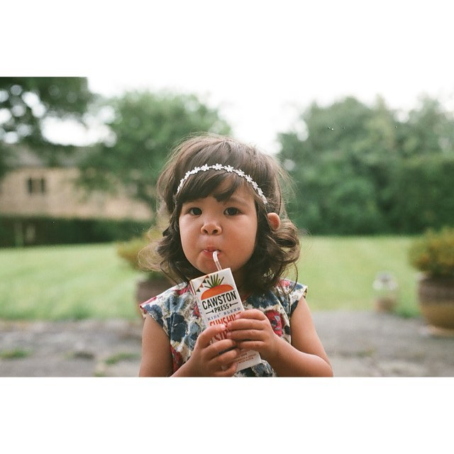 Girl drinking juice box