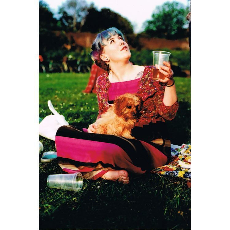 Girl with her dog holding a beer