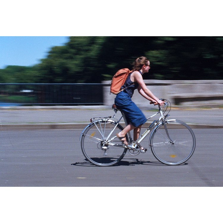 Person cycling past