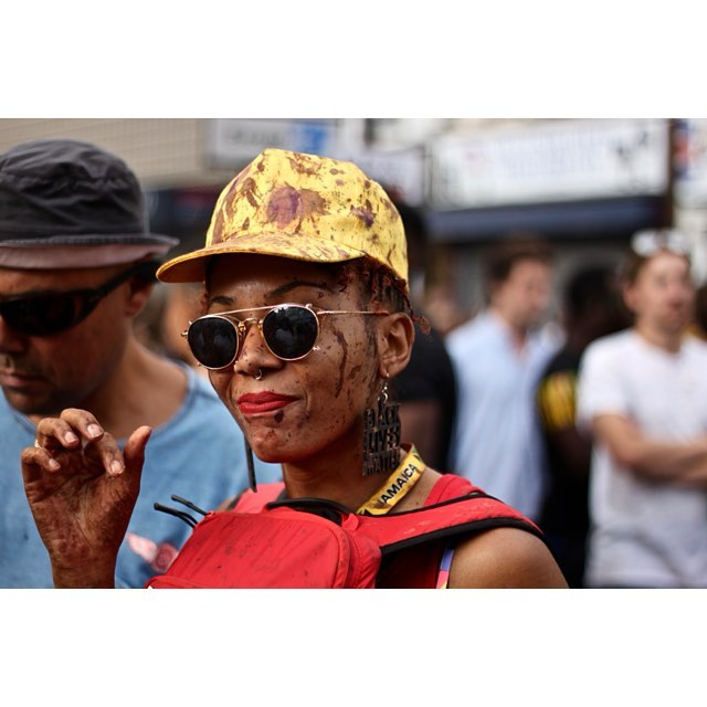 Woman in sunglasses with black lives matter earring