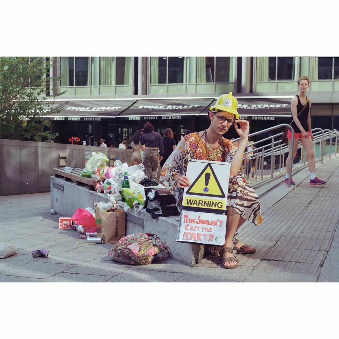 Man sitting next to lots of trash