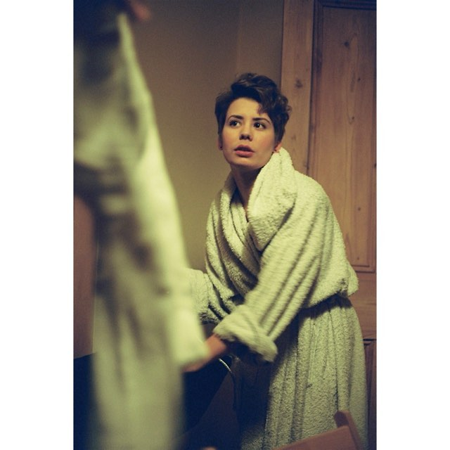 Woman posing in a dressing gown