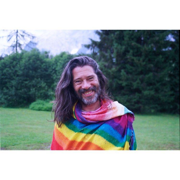 Man in rainbow throw