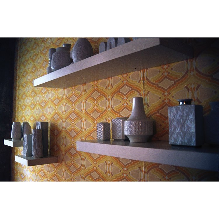 Shelves with 70s wallpaper
